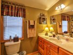 The upstairs bedroom boasts an en suite bathroom.