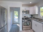 The kitchen features stainless steel appliances and plenty of counter space.