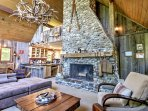 Sprawl out on the comfortable sectional sofa while the wood-burning fireplace warms the room.