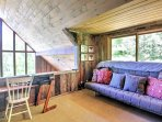 The upstairs loft features a cozy queen-sized futon for additional sleeping accommodations.