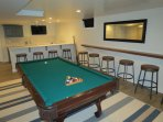And a pool table and bar area.