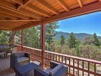 Sit back and enjoy the fabulous mountain views from the back deck during your stay at Peaceful Pines Retreat, a...