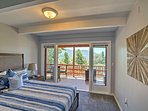 The third bedroom also has a queen-sized bed and access to the deck through a sliding glass door.