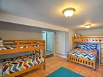 There is a twin-over-twin bunk bed and a twin-over-full bunk bed in the fourth bedroom.