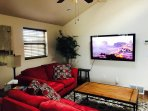60' Flat-screen in living room with Netflix,  CBS All Access, etc.  Internet access is provided.