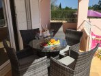 Small dining table and chairs in veranda