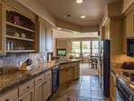 Large Kitchen With All Dishes and Cookware