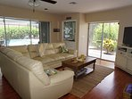 Family room with wet bar and lanai in the background