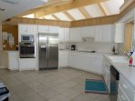Fully furnished kitchen with stainless steel appliances