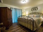 Master bedroom with king bed, warm decorations