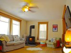 Warm up by the wood-stove or cool off with the ceiling fan