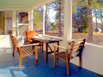 Take breakfast on the veranda, overlooking the field and farmhouses.
