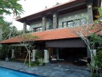 Beautiful Balinese style villa. Rental room is upstairs to your left.