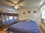 This bedroom has a twin-over-twin bunk bed and full bed.