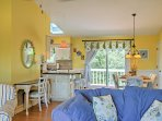Vibrant colors, nautical decor, and an open-concept layout embellish the interior.