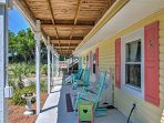 The lower-level porch offers a shady retreat and comfy rocking chairs.
