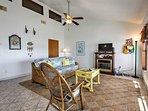 The home features an open-concept living space with beach decor.
