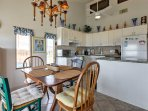Sit at the quaint dining table to share your home-cooked meals.