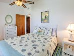 The master bedroom provides a queen-sized bed.