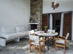 A cosy outside dining area with BBq