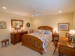 Second queen bedroom has a cozy country charm that fits with the beautiful nature of the home.