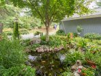Enjoy a peaceful time by the pond. A charming oasis.