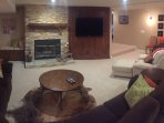 Relaxing media room is the ideal spot for watching sporting events and movies