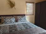 Comfortable super king-size bed with luxurious mattress