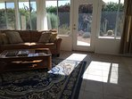 Sun room with Vaulted ceiling overlooking back private cactus yard!