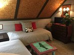 Large upstairs bedroom with chalet style vaulted ceiling