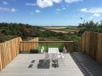 Stunning countryside views enjoyed from a decked suntrap