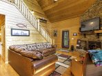 Curl up on the plush couch in the living area and warm your toes by the wood-burning fireplace.