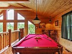 Upstairs, you can challenge your travel companions to a game of pool.