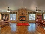 An open-concept layout, high ceilings, hardwood floors and a rustic fireplace mantle welcome you in the home's great...