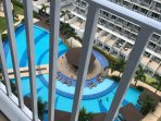 Nice refreshing view of the amenity area at your own balcony. Patio table and chair is provided