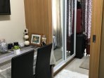 Two sliding glass mirror cabinet where you can store your personal belongings.