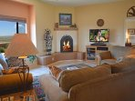 Peace and serenity of a gas log fireplace from comfy upgrade sofa and chairs