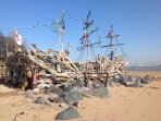 Life sized driftwood ship near by.