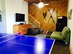 Commercial Ping Pong table and another 55' flat screen TV