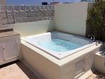 private rooftop terrace with a jacuzzi