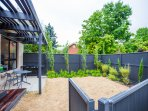 Private fenced garden with BBQ & outside dining