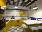Kitchen with all main utensils and appliances: oven, dishwasher and washing machine included.