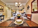 FULL FORMAL DINING ROOM TO KITCHEN.
