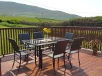 Spacious Deck off kitchen/Dining room. Overlooks large back lawn, fields, mountains and ocean.
