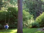 Kids love this swing at the front yard surrounded by beautiful garden. There's also a big sandbox.
