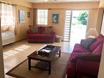 Spacious living room with door opening to large porch and pool area