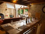 Large oak table with open plan lounge and french windows leading to views of the courtyard.