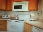 Completely outfitted kitchen with modern appliances including dishwasher.  Food Market close by too