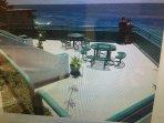shared first floor resort deck overlooking the beach and ocean