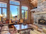 The main living room has picture windows with breathtaking mountain views